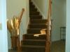 Oak railing with carpet runner